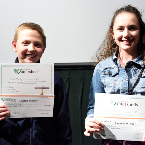 Two students proudly holding their Caring for our Watersheds certificates at the 2018 Final Competition